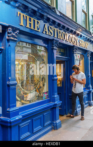 London, UK - June 16, 2016: unique astrology shop with unidentified person in London. London is the capital of England - Stock Photo