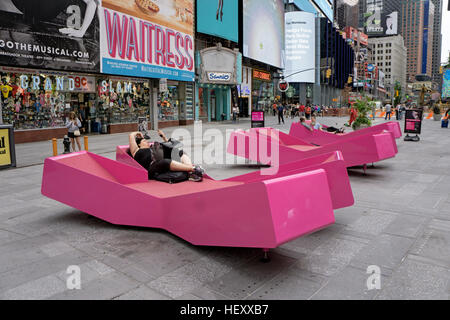 A street furniture installation in Times Square. 3 X shaped lounge chairs honoring the area's x rated past - Stock Photo