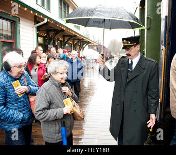 Polar Express Christmas train ride conductor Rob Payette at the West Coast Railway Park.  Squamish BC, Canada - Stock Photo