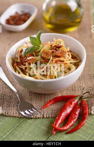 Spaghetti with garlic, oil and hot pepper - traditional Italian recipe - Stock Photo
