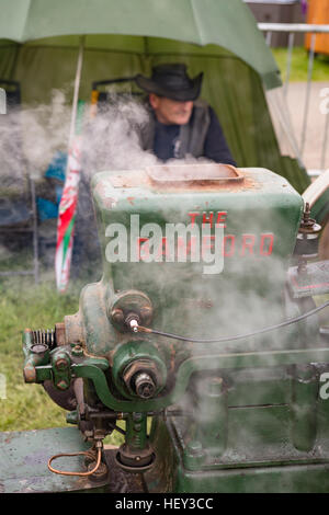 A vintage Stationary Engine, The Bamford, with its owner at a county show. - Stock Photo