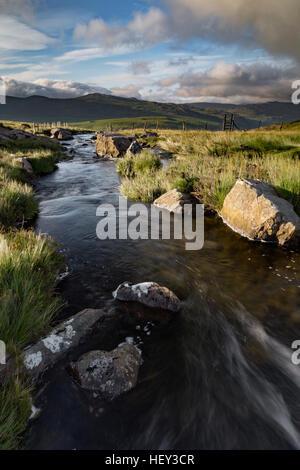 Nant Gwryd flows from Llyn Cwmffynnon in Snowdonia, Wales - Stock Photo