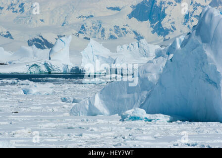 icebergs and the ice in the Strait near the west coast of the Antarctic Peninsula - Stock Photo