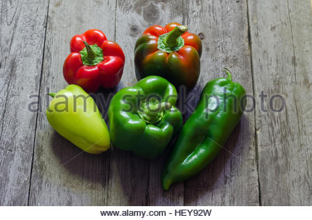 Fresh red pepper on wooden background, selective focus - Stock Photo