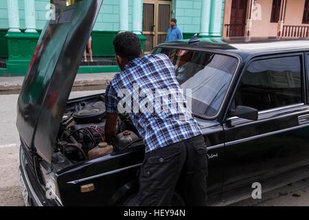 Fixing a car on the roadside in Baracoa, Cuba - Stock Photo