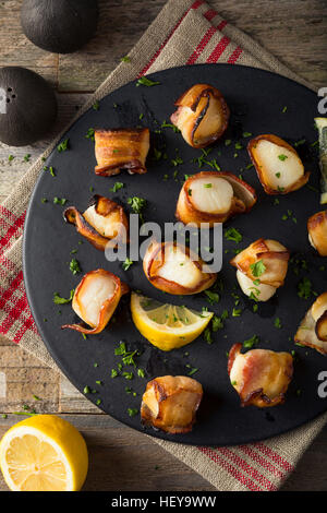 Homemade Bacon Wrapped Scallops with Salt and Pepper - Stock Photo