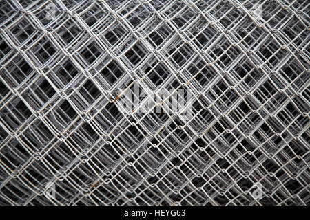 Large roll of galvanized wire mesh fence - Stock Photo