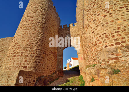 Portugal, Alentejo: View through the castle fortress of Evoramonte with small chapel in the background - Stock Photo