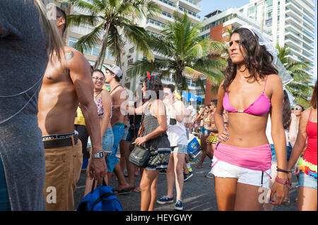 RIO DE JANEIRO - FEBRUARY 14, 2015: Vendors and revelers share the Ipanema beachfront at a Carnival street party. - Stock Photo