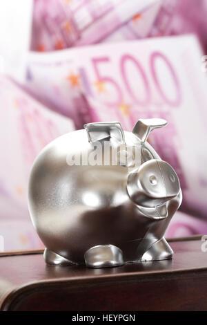 Silver piggy bank, 500-Euro bills (back) - Stock Photo