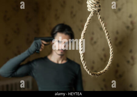 Man commit suicide with a shot in the head. - Stock Photo