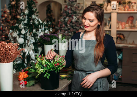 emale hands with bouquet of flowers closeup - Stock Photo