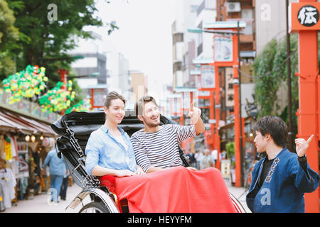 Caucasian couple enjoying sightseeing in Tokyo, Japan - Stock Photo