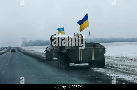 Krasnoarmeysk. 24th Dec, 2016. Photo taken on Dec. 24, 2016 shows Ukrainian army's armored vehicles withdrawn from - Stock Photo