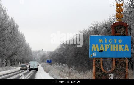 Krasnoarmeysk. 24th Dec, 2016. Photo taken on Dec. 24, 2016 shows vehicles running on the way to marinka, Donetsk - Stock Photo