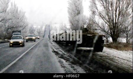 Krasnoarmeysk. 24th Dec, 2016. Photo taken on Dec. 24, 2016 shows Ukrainian army's armored vehicles withdrawn from - Stock Photo