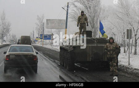 Krasnoarmeysk. 24th Dec, 2016. Photo taken on Dec. 24, 2016 shows a Ukrainian army's armored vehicle withdrawn from - Stock Photo