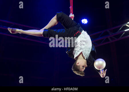 The artist Anton Mikheev performs during the premiere of the Circus Krone winter program in Munich, Germany, 25 - Stock Photo