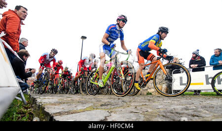 Gijon, Spain. 26th December, 2016. Cyclists ride during the start of Cyclocross of Gijon celebrated at Los Pericones - Stock Photo