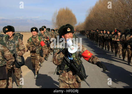 Yinchuan, China. 26th Dec, 2016. .Soldiers take part in winter training outdoors in cold weather in Yinchuan, capital - Stock Photo
