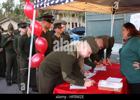 Marines from Marine Corps Air Station Miramar sign in at the Summit for Children Worldwide Holiday with Heroes event - Stock Photo