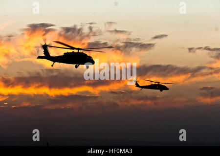 Two UH-60 Black Hawk helicopters hover over the skies of Spin Boldak, in the southern Kandahar province, Afghanistan, - Stock Photo