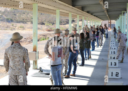 Spouses from Headquaters and headquarters Squadron meet with their shooting instructors during Jane Wayne Day at - Stock Photo