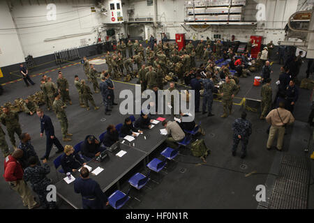 Role players are welcomed and processed aboard USS Iwo Jima after being evacuated by Marines and Sailors with 24th - Stock Photo
