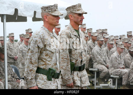 Lt. Col. Gregory T. Puntney, left, the outgoing commanding officer of Marine Wing Communication Squadron 28, 2nd - Stock Photo