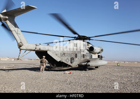 A U.S. Marine Corps CH-53D Sea Stallion with Marine Heavy Helicopter Squadron 362, 3D Marine Aircraft Wing (Forward) sits on Camp Delaram II, Nimroz province, Afghanistan May 26, 2012. The helicopter transported U.S. Marines with Regional Command (SouthWest) and Afghan National Army soldiers with 4th Kandak, 2nd Brigade, 215th Corps to Forward Operating Base Edinburgh. (U.S. Marine Corps photo by Staff Sgt. Raul Gonzalez/Released) Air interdiction mission 120526-M-KH643-014 Stock Photo