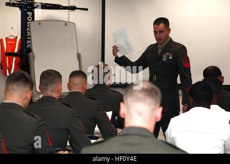 Sgt. Michael A. Blaul, an instructor for Cherry Point Corporals Leadership Course, explains the check-in process - Stock Photo