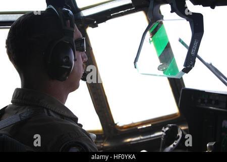 U.S. Marine Corps Capt. John Brampton, KC-130J pilot, with Marine Aerial Refueler Transport Squadron 352 (VMGR-352), - Stock Photo