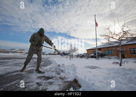Staff Sgt. Gary Sill removes snow from the 108th Wing's headquarters' walkway at Joint Base McGuire-Dix-Lakehurst, - Stock Photo