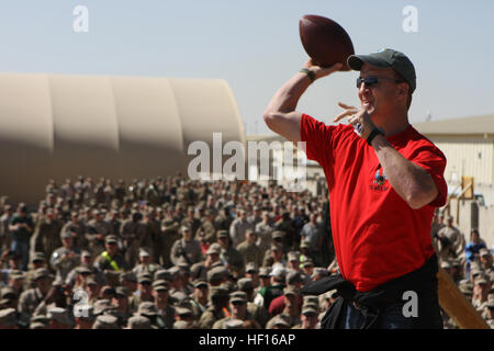 Four-time National Football League Most Valuable Player and Denver Broncos quarterback Peyton Manning demonstrates - Stock Photo
