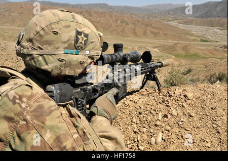 Spc. Daniel S. Kennedy, from Tuttle, Okla., with 2nd Battalion, 23rd Infantry Regiment, provides security as Afghan - Stock Photo