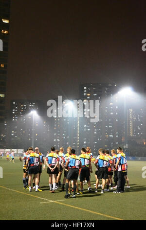 HONG KONG (April 17, 2013) Marines and sailors from the Peleliu Amphibious Ready Group huddle before a rugby match - Stock Photo