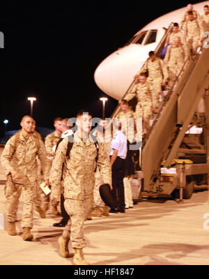 Marines with Lima Company, 3rd Battalion, 3rd Marine Regiment, depart the plane upon their arrival aboard RAAF Base - Stock Photo