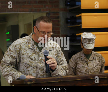 Lt. Cmdr. Danny Purvis, a member of the Chaplain Corps aboard Camp Lejeune, N.C., leads the room in an invocation - Stock Photo