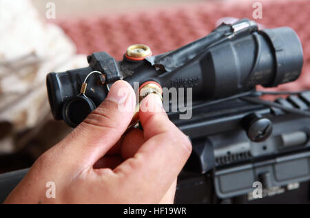 A Marine with Lima Company, 3rd Battalion, 3rd Marine Regiment, Marine Rotational Force - Darwin, adjusts the sights - Stock Photo