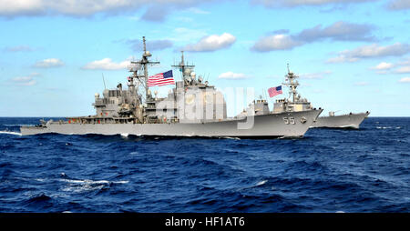The Ticonderoga-class guided-missile cruiser USS Leyte Gulf and the Arleigh Burke-class guided-missile destroyer - Stock Photo