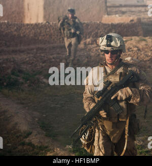 U.S. Marines with Fox Company, 2nd Battalion, 2nd Marine Regiment patrol during a cordon and search mission in Habib - Stock Photo