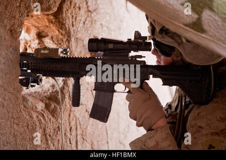 A U.S. Marine with Fox Company, 2nd Battalion, 2nd Marines provides security for a compound in Habib Abad, Helmand - Stock Photo