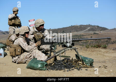 MARINE CORPS BASE CAMP PENDLETON, Calif. – Lance Cpl. William Krueck (right), a machine gunner with Alpha Company, - Stock Photo