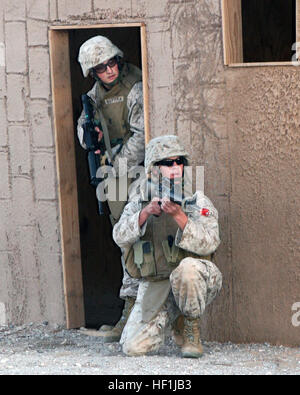 071210-M-6020M-013 YUMA, Ariz. (Dec. 10, 2007) A Marine and a Sailor, both assigned to Marine Wing Support Squadron - Stock Photo