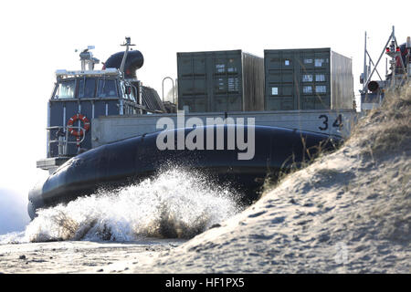 A Landing Craft Air Cushion makes landfall with personnel and equipment from the 26th Marine Expeditionary Unit - Stock Photo