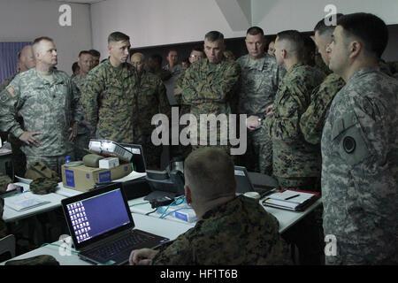 U.S. Marine Corps Lt. Gen. John E. Wissler, commander of Joint Task Force 505 (JTF-505), receives  his morning update - Stock Photo