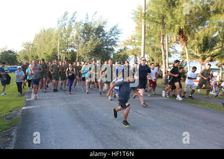 Participants in the 2nd Tinian Hafa Adai 5 kilometer run take off sprinting Nov. 30, after the start buzzer rang. - Stock Photo