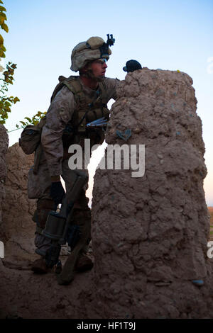 Lance Cpl. Nathan Gulbronson, a Lambertville, Mich., native and rifleman with 1st Battalion, 9th Marines, stands - Stock Photo