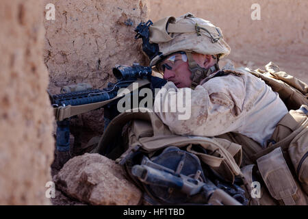 Lance Cpl. Nathan Gulbronson, a Lambertville, Mich., native and rifleman with 1st Battalion, 9th Marines, provides - Stock Photo