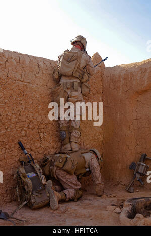 Lance Cpl. Nathan Gulbronson (top), a Lambertville, Mich., native stands atop Lance Cpl. Brandon Bowker, a Roberta, - Stock Photo